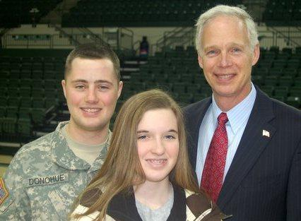 Senator Johnson with member of the 432nd Civil Affairs Battalion